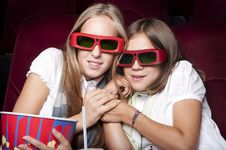 Free Two Beautiful Girls Watching A Movie At The Cinema Stock Images - 21081154
