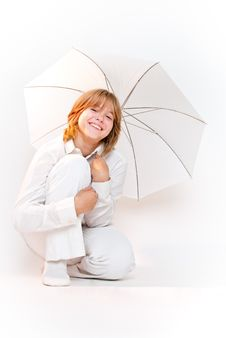 Free Girl Sitting With Umbrella And Smiling Stock Image - 21088451