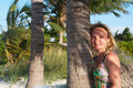 Free A Young Women Is Standing Next To The Palm Tree Royalty Free Stock Photos - 21094548