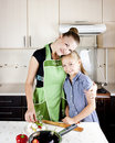 Free Woman With A Daughter In The Kitchen Preparing Royalty Free Stock Photography - 21099597