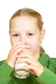 Free Happy Little Girl With A Glass Of Milk Royalty Free Stock Photos - 21090048