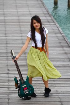 Free Young Pretty Woman With Guitar On Bridge Royalty Free Stock Photos - 21092258