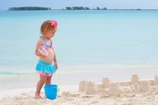 Free Baby Girl Is Playing On The Beach Royalty Free Stock Photo - 21094525