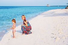 Free A Mother And A Baby On The Beach Stock Photo - 21094530
