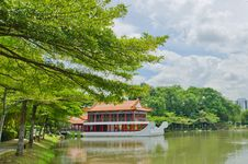 Old Chinese Building With Water Clouds And Trees Stock Photo