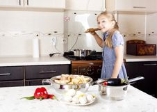 Free Little Girl Preparing Food In The Kitchen Royalty Free Stock Photography - 21099547