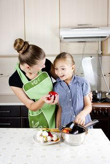 Free Woman With A Daughter In The Kitchen Preparing Stock Photography - 21099632