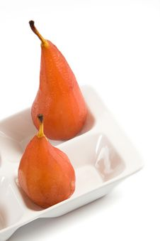 Close-up Of Two Pears Poached In Red Wine Royalty Free Stock Image
