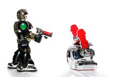 2 Toy Robots: Hands Up!! Royalty Free Stock Photo