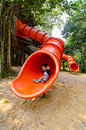 Free Happy Toddler Pre Schooler Sliding Down Red Slide Royalty Free Stock Photo - 21105775