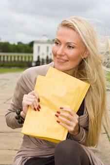 Free Woman Holding Envelopes Royalty Free Stock Photos - 21102908
