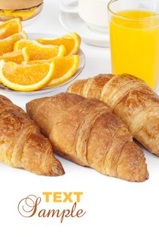 Free Croissant Bun With Orange Juice Royalty Free Stock Images - 21103469