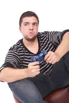 Free Young And Furious Man With A Joystick Stock Photo - 21103670