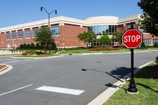 Free Road Intersection With Stop Sign Near Office Stock Photography - 21106062