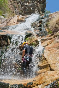Free Men Descending Waterfall Royalty Free Stock Image - 21106926