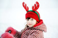 Portrait Of Adorable Child Girl In Horned Hat Royalty Free Stock Photo