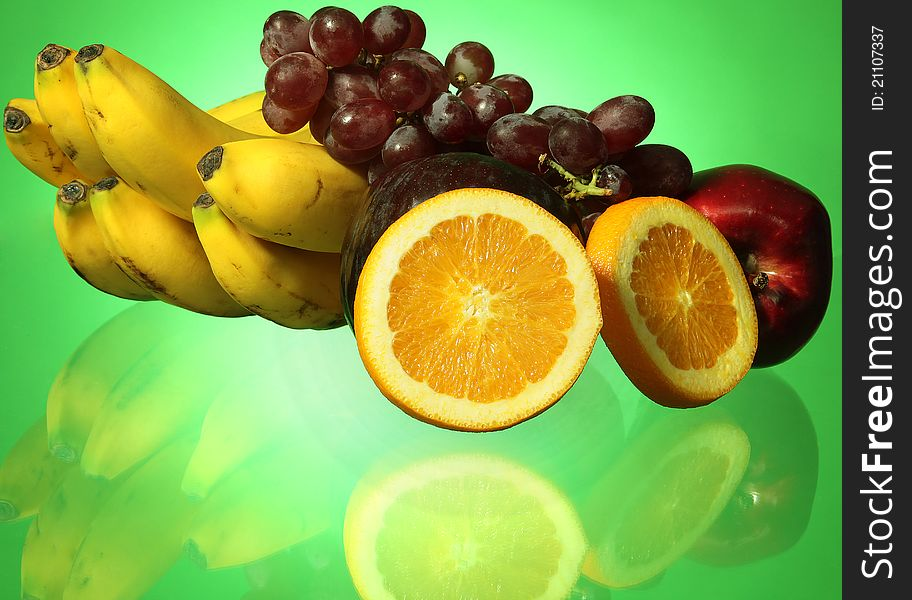 Fruit on green background