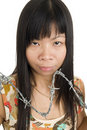 Free Asian Woman Behind Barbed Wire Royalty Free Stock Images - 21110989
