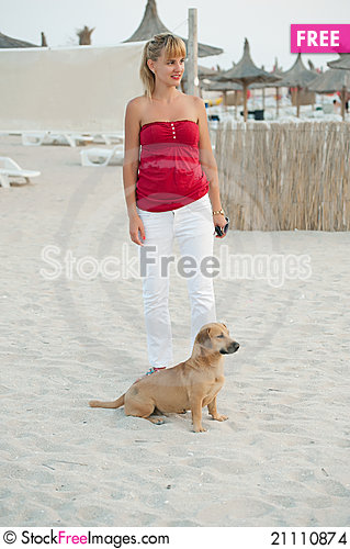 Free Young Woman Playing With Her Dog On The Beach. Stock Images - 21110874