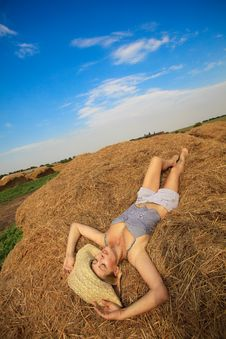 Free Woman Relaxing In Hay Stack Royalty Free Stock Photography - 21111797