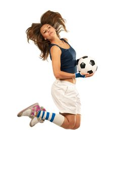 Girl Jumpig With Soccer Ball Stock Photo