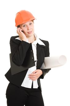 Businesswoman In A Helmet With A Mobile Phone Royalty Free Stock Photo