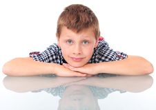 Free Boy Leaning On School Desk Royalty Free Stock Photography - 21113527