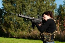 Free Beautiful Girl With A Gun Royalty Free Stock Photo - 21116005