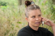 Free Middle-aged Woman Talking On Phone Royalty Free Stock Image - 21118866