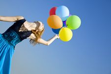 Girl With Colour Balloons At Blue Sky Background. Royalty Free Stock Photos
