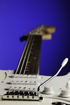 Free White Guitar Isolated On Blue Royalty Free Stock Photos - 21119238