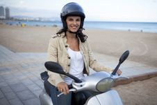 Free Attractive Woman On A Scooter Stock Photo - 21121680
