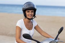 Free Attractive Woman On A Scooter Royalty Free Stock Photos - 21121978