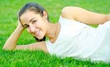 Beautiful Teen Resting On Grass Royalty Free Stock Photo