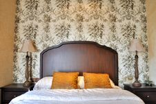 Free Bedroom Flowery Wall Paper And Wooden Furniture Stock Photography - 21124882