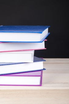 Free Pile Of Five Colorful Books On A Wooden Table Stock Images - 21130054