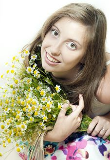 Young  Smiling Girl With Camomile Stock Image