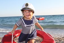 Free Happy Girl In Sailor Hat On Beach Stock Photo - 21131120