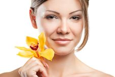Free Young Beautiful Woman With Orchid Royalty Free Stock Image - 21131596