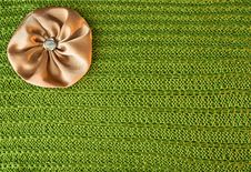 Free Background With A Green Knit Texture And Brown Bow Stock Photos - 21132813