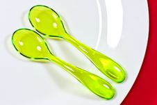 Two Yellow Plastic Spoons Stock Photography