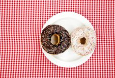 A Couple Of Donuts On Table. Royalty Free Stock Photo