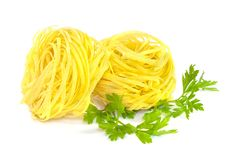 Raw Pasta Nests And Green Parsley On White Royalty Free Stock Image