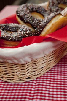 A Couple Of Donuts On Table. Royalty Free Stock Image