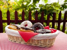 A Couple Of Donuts On Table. Stock Photos