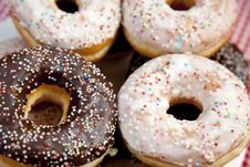 A Couple Of Donuts On Table. Royalty Free Stock Photos
