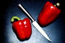 Knife And Peppers Royalty Free Stock Photo