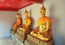 Free Golden Sitting Buddha Statues In Wat Pho Stock Images - 21141034