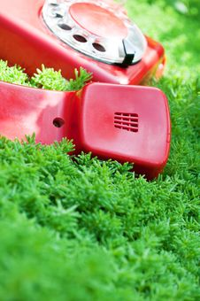 Free Red And Old Telephone On A Green Grass Stock Photo - 21142620
