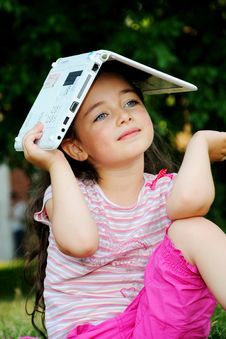 The Little Girl With The Laptop Royalty Free Stock Photo